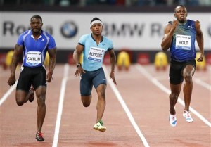 Bolt of Jamaica competes with Gatlin of the U.S. during the men's 100m event at the Golden Gala IAAF Diamond League at the Olympic stadium in Rome